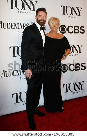 NEW YORK-JUNE 8: Actor Hugh Jackman (L) and wife  Deborra-Lee Furness attend American Theatre Wing's 68th Annual Tony Awards at Radio City Music Hall on June 8, 2014 in New York City. - stock photo