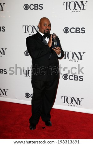 NEW YORK-JUNE 8: Actor James Monroe Iglehart poses in the press room at the American Theatre Wing's 68th Annual Tony Awards at Radio City Music Hall on June 8, 2014 in New York City. - stock photo