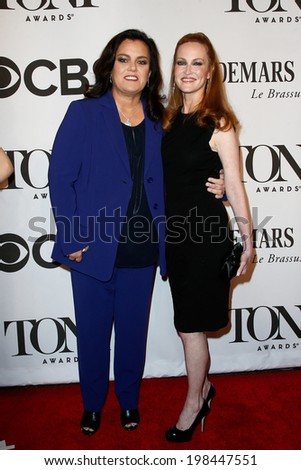 NEW YORK-JUNE 8: Actress Rosie O'Donnell (L) and wife Michelle Rounds attend American Theatre Wing's 68th Annual Tony Awards at Radio City Music Hall on June 8, 2014 in New York City. - stock photo