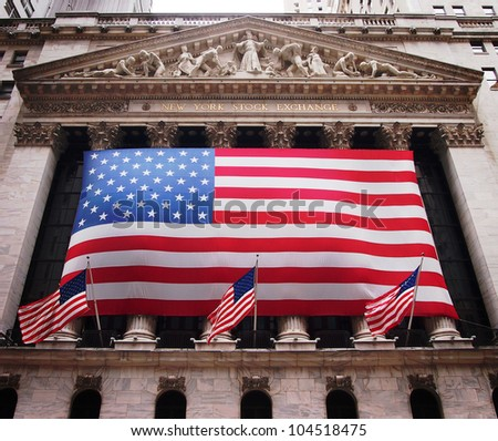 NEW YORK, JUNE 1: An American flag hangs on the front of the New York Stock Exchange building in New York City, June 1, 2012.  - stock photo