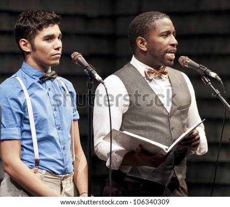 NEW YORK - JUNE 25: Anthony Lee Medina and Angelo Rios perform at the Broadway Sings for Pride's 2nd Annual Gay Pride Concert at the Main Stage Theater on June 25, 2012 in New York City. - stock photo