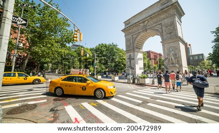 NEW YORK - JUNE 16: Arch in Washington Square Park on June 16, 2014 in New York. Washington Square Park is one of the best-known of New York City's 1,900 public parks. - stock photo
