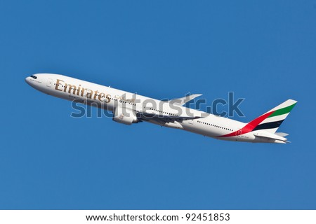 NEW YORK - JUNE 10: Boeing 777 Emirates climbs after take off from JFK airport located in New York, June 10, 2011. Emirates is rated as a top10 best airline in the world flying on youngest fleet - stock photo