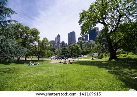 NEW YORK - JUNE 5: Central Park on June 5, 2013 in New York. Central Park is a public park at the center of Manhattan in New York City. - stock photo