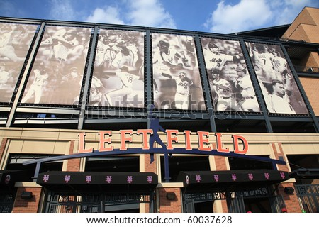 NEW YORK - June 23: Closeup of brick and concrete Citi Field with famous Mets players depicted at Left Field gate entrance on June 23, 2010 in New York. - stock photo