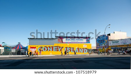 NEW YORK - JUNE 27: Coney Island murales on June 27, 2012 in NY. Coney Island is the westernmost part of the barrier islands of Long Island, about 4 miles (6.4 km) long and 0.5 miles (0.80 km) wide. - stock photo