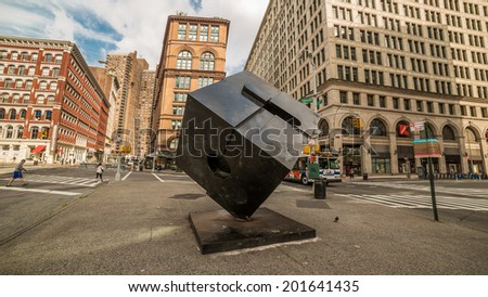 NEW YORK - JUNE 21: Cooper Square on June 21, 2014 in New York. Cooper Square is located at the confluence of the neighborhoods of Bowery, NoHo, Greenwich Village, the East Village, and LES. - stock photo