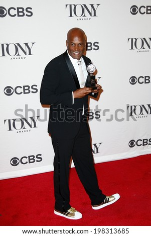 NEW YORK-JUNE 8: Director Kenny Leon poses in the press room at the American Theatre Wing's 68th Annual Tony Awards at Radio City Music Hall on June 8, 2014 in New York City. - stock photo