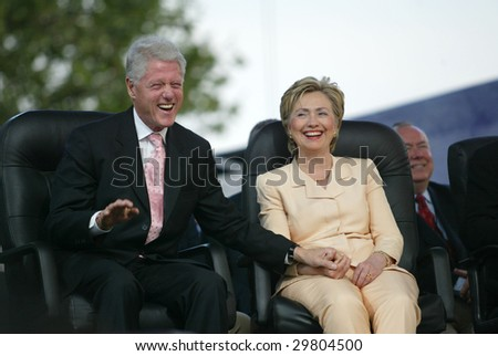 NEW YORK - JUNE 25: Former U.S. President Bill Clinton and wife, U.S. Senator Hillary Clinton (D-NY), laugh at the Greater New York Billy Graham Crusade June 25, 2005 in Flushing, New York.