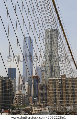 NEW YORK - JUNE 17 Freedom Tower and Beekman Tower view from the Brooklyn Bridge on June 17, 2014 The Brooklyn Bridge is an icon of New York and was designated a National Historic Landmark in 1964  - stock photo
