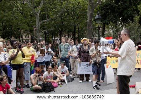 NEW YORK - JUNE 22: Jay Toole speaks to the audience of supporters in Washington Square Park during the 8th Annual Trans Day of Action on June 22, 2012 in New York City. - stock photo