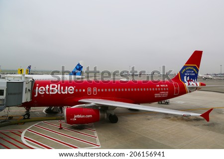 NEW YORK- JUNE 10: JetBlue Airbus A320 Honoring the brave men and women Fire Department City of NY at the gate at the Terminal 5 at John F Kennedy International Airport in New York on June 10, 2014  - stock photo