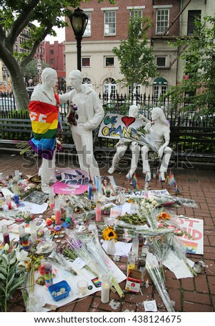 NEW YORK - JUNE 16, 2016: Memorial at Gay Liberation sculptures in Christopher Park  for the victims of the mass shooting in Pulse Club, Orlando in New York City