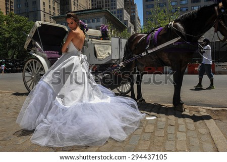NEW YORK - June 13: Model Kalyn Hemphill pose in front of horse carriage at the Irina Shabayeva SS 2016 Bridal collection photoshoot on June 13, 2015 in New York, USA - stock photo