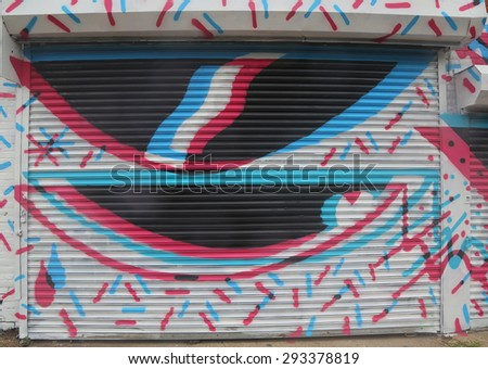 NEW YORK - JUNE 16, 2015: Mural art at Wellington Court in Astoria section in Queens. A mural is any piece of artwork painted or applied directly on a wall, ceiling or other large permanent surface