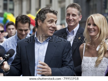 NEW YORK - JUNE 26: New York Governor Andrew Cuomo, Sandra Lee attend press conference at pride parade on June 26, 2011 in New York City, NY. - stock photo
