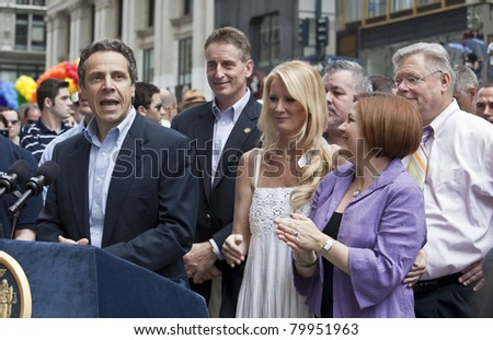 NEW YORK - JUNE 26: New York Governor Andrew Cuomo, Sandra Lee, City Council speaker Christine Quinn, New York State Senator Tom Duane attend press conference at pride parade on June 26, 2011 in NYC