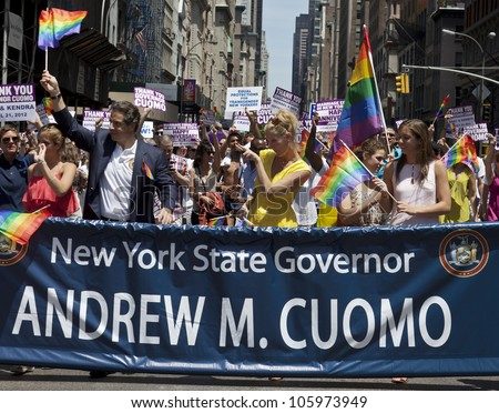 NEW YORK - JUNE 24: New York State Governor Andrew Cuomo and Sandra Lee attend 2012 New York City's Pride March in New York on June 24, 2012. - stock photo