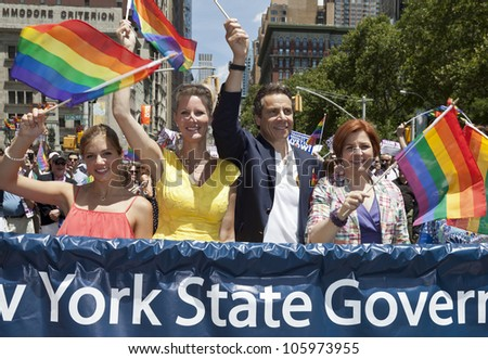 NEW YORK - JUNE 24: New York State Governor Andrew Cuomo City Council Speaker Christine Quinn and Sandra Lee attend 2012 New York City's Pride March in New York on June 24, 2012. - stock photo