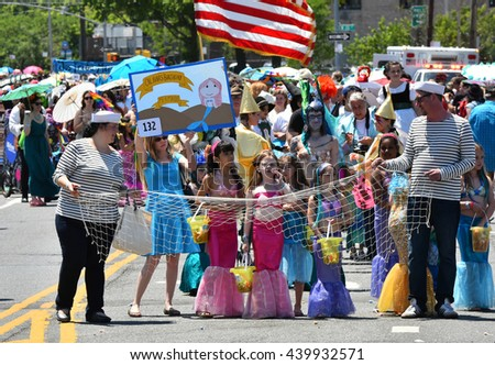 NEW YORK - JUNE 18, 2016: Participants march in the 34th Annual Mermaid Parade at Coney Island, the largest parade in the nation and a celebration of ancient mythology on June 18, 2016 in Brooklyn NY.
