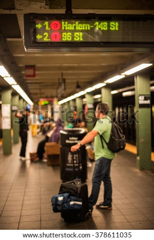 NEW YORK - JUNE 22: Passenger with bags waiting for metro a train in New York City metro station, June 22, 2015 New York City. USA. - stock photo