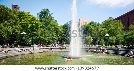 NEW YORK - JUNE 28: People relaxing in Washington Square Park. With 9.75 acres (39,500 m2), it is a landmark in the Manhattan neighborhood of Greenwich Village, seen on June 28, 2012 in New York, NY. - stock photo