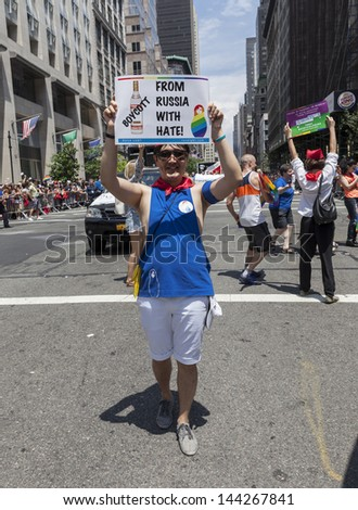 NEW YORK - JUNE 30: Protesters against anti-gay policies of Russian government during annual 43rd Pride Parade on Fifth Avenue in Manhattan on June 30, 2013 in New York City - stock photo