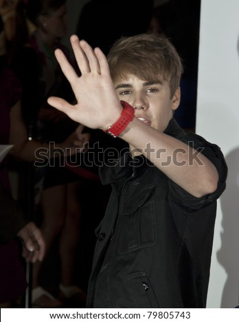 NEW YORK - JUNE 23: Singer Justin Bieber attends the 'Monte Carlo' screening at AMC Loews Lincoln Square on June 23, 2011 in New York City. - stock photo