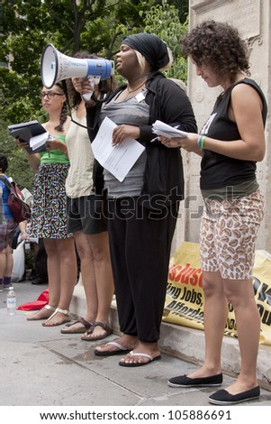 NEW YORK - JUNE 22: Speakers address an audience of supporters in Washington Square Park during the 8th Annual Trans Day of Action on June 22, 2012 in New York City. - stock photo