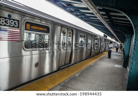 NEW YORK - JUNE 11: subway platform on June 11, 2014 in New York. The New York City Subway is a rapid transit system owned by the City of New York and leased to the New York City Transit Authority. - stock photo