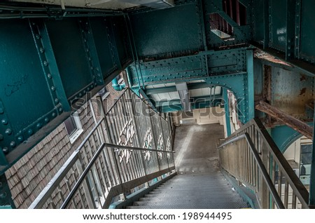 NEW YORK - JUNE 11: subway stairs on June 11, 2014 in New York. The New York City Subway is a rapid transit system owned by the City of New York and leased to the New York City Transit Authority. - stock photo