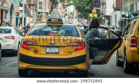 NEW YORK - JUNE 14: taxicab on June 14, 2014 in New York. Canary yellow in color, medallion taxis are able to pick up passengers anywhere in the five boroughs. - stock photo