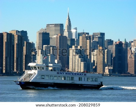 NEW YORK - June 9th: Ferry and NY skyscrapers including the Chrysler Building on June 9th, 2014 in New York.1,046 feet tall, the Chrysler was the world's tallest building prior to the Empire State.  - stock photo