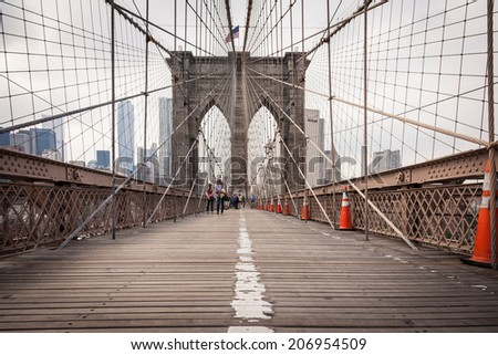 NEW YORK - JUNE 10, 2014: The Brooklyn bridge June 2014 in New York City. The Brooklyn Bridge is one of the oldest suspension bridges in the United States.