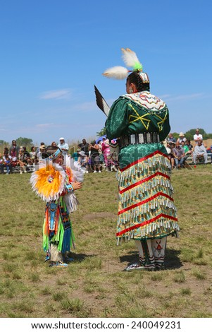 NEW YORK - JUNE 8:Unidentified female Native American dancer wears traditional Pow Wow dress during the NYC Pow Wow in Brooklyn on June 8, 2014