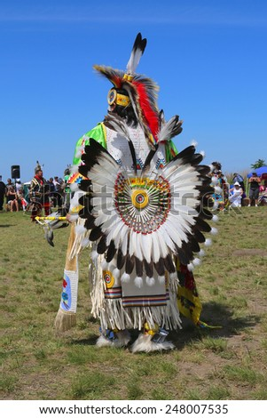 NEW YORK - JUNE 8, 2014: Unidentified male Native American dancer wears traditional Pow Wow dress with Dance Bustle during the NYC Pow Wow in Brooklyn - stock photo