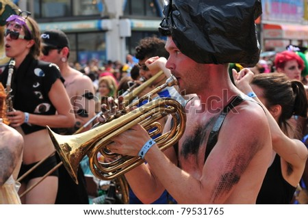 NEW YORK - JUNE 18: Unidentified participant attends Mermaid parade on Coney Island in Brooklyn on June 18, 2011 in New York City.