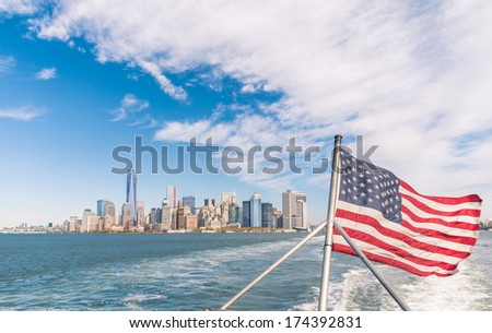 New York - Manhattan skyline from Hudson river with American Flag - stock photo