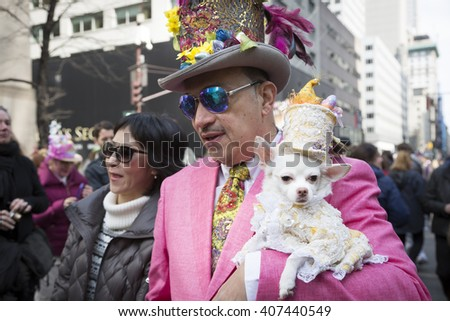 NEW YORK - MAR 27 2016: A dog wearing an Easter costume is carried by its owner on 5th Avenue Easter Sunday during the traditional Easter Bonnet Parade in Manhattan on March 27, 2016. - stock photo