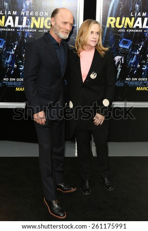 """NEW YORK-MAR 9: Actors Amy Madigan (R) and Ed Harris attend the premiere of """"Run All Night"""" at AMC Loews Lincoln Square on March 9, 2015 in New York City. - stock photo"""