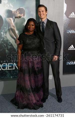 """NEW YORK-MAR 16: Actors Octavia Spencer (L) and Ansel Elgort attend the U.S. premiere of """"The Divergent Series: Insurgent"""" at the Ziegfeld Theatre on March 16, 2015 in New York City. - stock photo"""