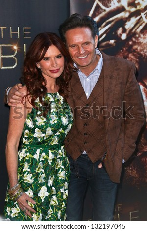 """NEW YORK-MAR 19: Actress Roma Downey and husband Mark Burnett attend the opening night gala of """"The Bible Experience"""" on March 19, 2013 in New York City. - stock photo"""