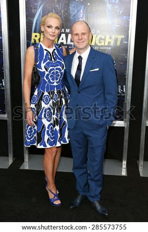 "NEW YORK-MAR 9: Composer Tom Holkenborg (R) and wife Saskia attend the premiere of ""Run All Night"" at AMC Loews Lincoln Square on March 9, 2015 in New York City. - stock photo"