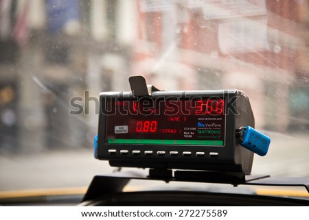 NEW YORK - MAR 21: View from cab with meter display in New York City on March 21, 2015. Yellow cabs are ubiquitous in Manhattan. - stock photo