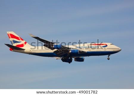 """NEW YORK - MARCH 1: A Boeing 747-400 British Airways """"Speedbird"""" arriving on JFK Airport Runway 4R on March 1, 2010 in New York - stock photo"""