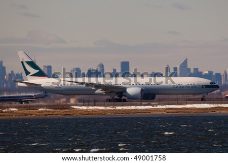 NEW YORK - MARCH 1: A Boeing 777 Cathay Pacific  departing form JFK Airport Runway 4R on March 1, 2010 in New York - stock photo