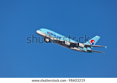 NEW YORK - MARCH 21:A380 Korean Air climbs after takeoff for JFK in New York, USA on March 21, 2011 Blue top livery was introduced on in 1984 A380 is the biggest passenger plane in the world - stock photo