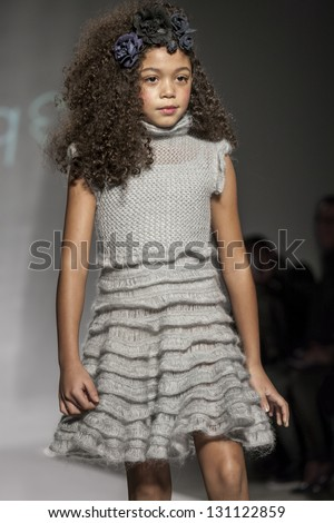 NEW YORK - MARCH 10: A model walks the runway at Bonnie Young Collection Show for Fall/Winter 2013 during NY Kids Fashion Week at Industria Super Studio on March 10, 2013 in New York