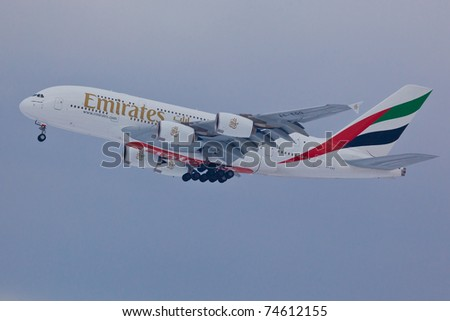 NEW YORK - MARCH 2: Airbus A380 Emirates approaching JFK airport located in New York, USA on March 2, 2011. A380 as of 2011 is the biggest plane ever used by commercial airlines in passengers transport - stock photo