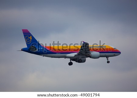NEW YORK - MARCH 1: Airbus A320 Jamaica Air arriving on JFK Airport Runway 4R on March 1, 2010 in New York - stock photo